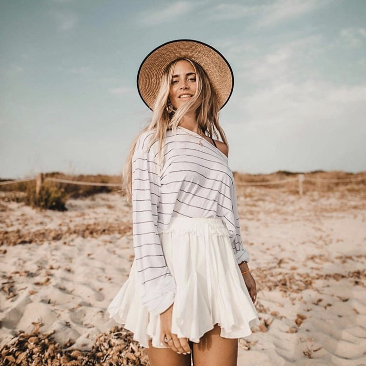 55a489238 lori_ciccarelli. Lowell, United States. White flowy Emilee Angelic Skort  from STORETS.