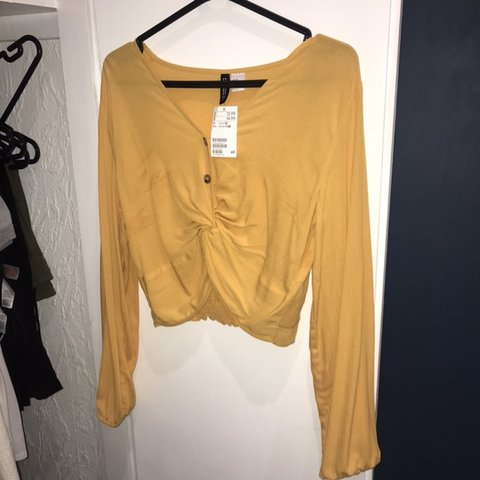 2d38a62b4f2 @jessescanlan. 6 months ago. Bognor Regis, United Kingdom. H&M mustard  colour crop top.