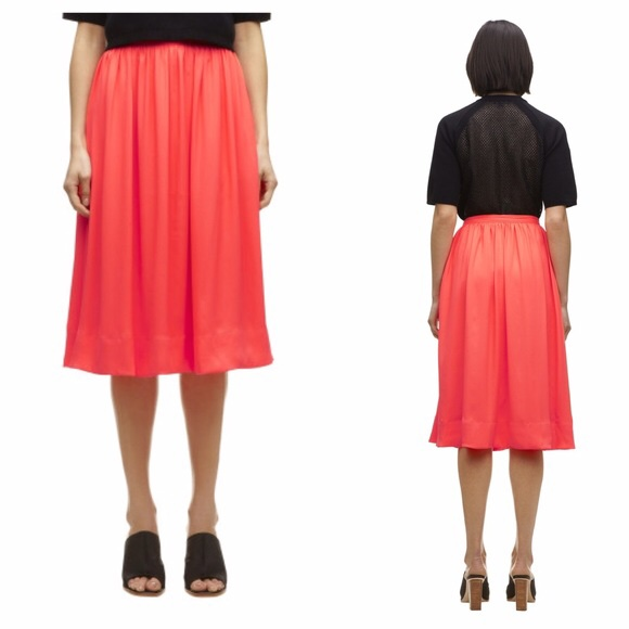 meet clearance prices on feet shots of Amazing Whistles bright coral midi skirt. Size... - Depop