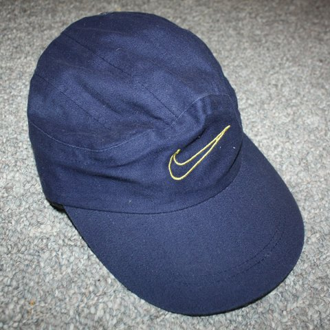 0ff2b2f5 Vintage white tag NIKE navy blue 5 panel hat with spell out - Depop