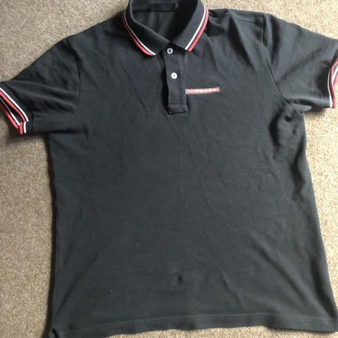 1c6725998 Prada polo, black and red, naughty lil piece, only worn a S - Depop