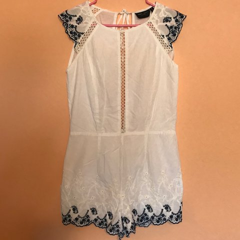 479933befb0 White romper with navy blue crochet lace accents. The front - Depop