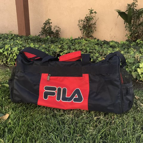 0c7491dd6689 WOAH. This vintage 90 s Fila gym bag carry on is FIRE. The - Depop