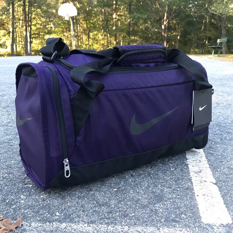 5608dbffe09916 @pvdvtg. 2 years ago. Pawtucket, United States. Deadstock vintage Nike dark  purple logo duffle bag *FREE SHIPPING