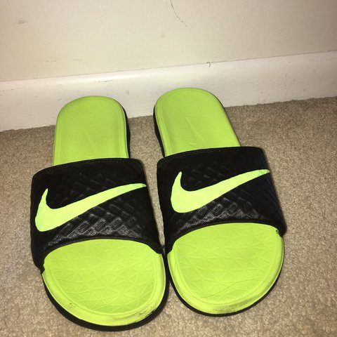 a718f74a1edf Neon Green Nike slides pretty new barely worn good for the - Depop