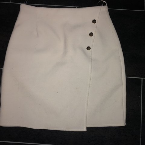b62eb637b @dann1998. 8 months ago. London, United Kingdom. White skirt with gold  buttons looks lovely on!! Summer bodycon skirt