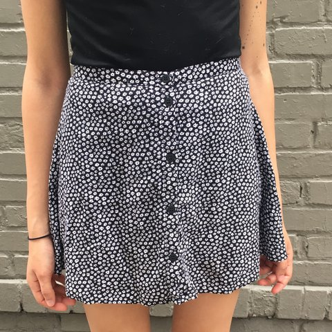 ab7012a1cb8f The cutest black and white floral mini button up skirt. Size - Depop