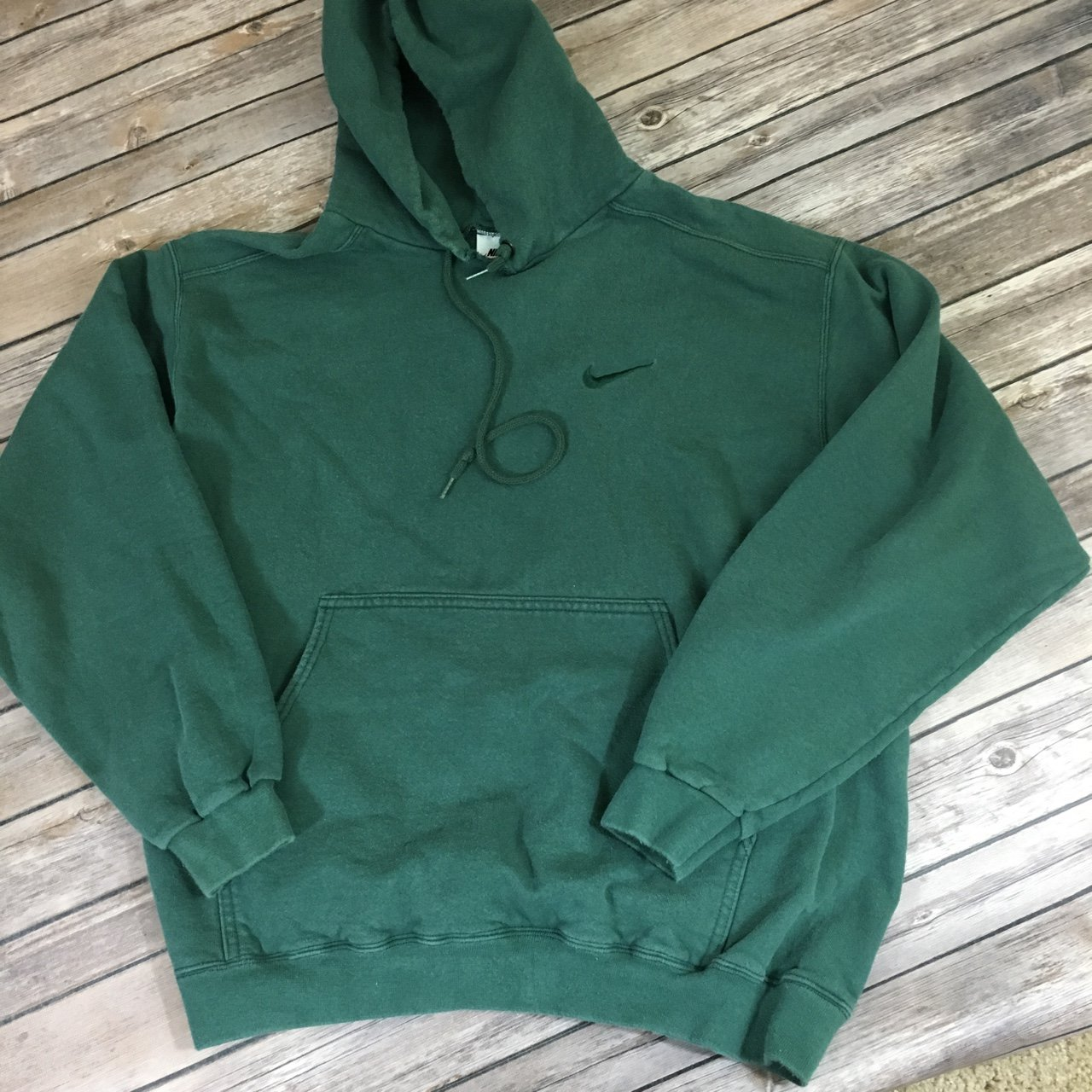 Vintage Nike dark green hoodie size men's medium. Depop