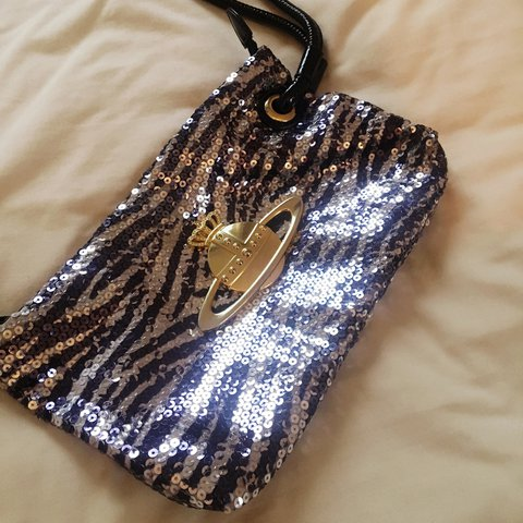 53e5b391021 Sequin clutch bag with wrist strap. Navy/grey sequins with a - Depop