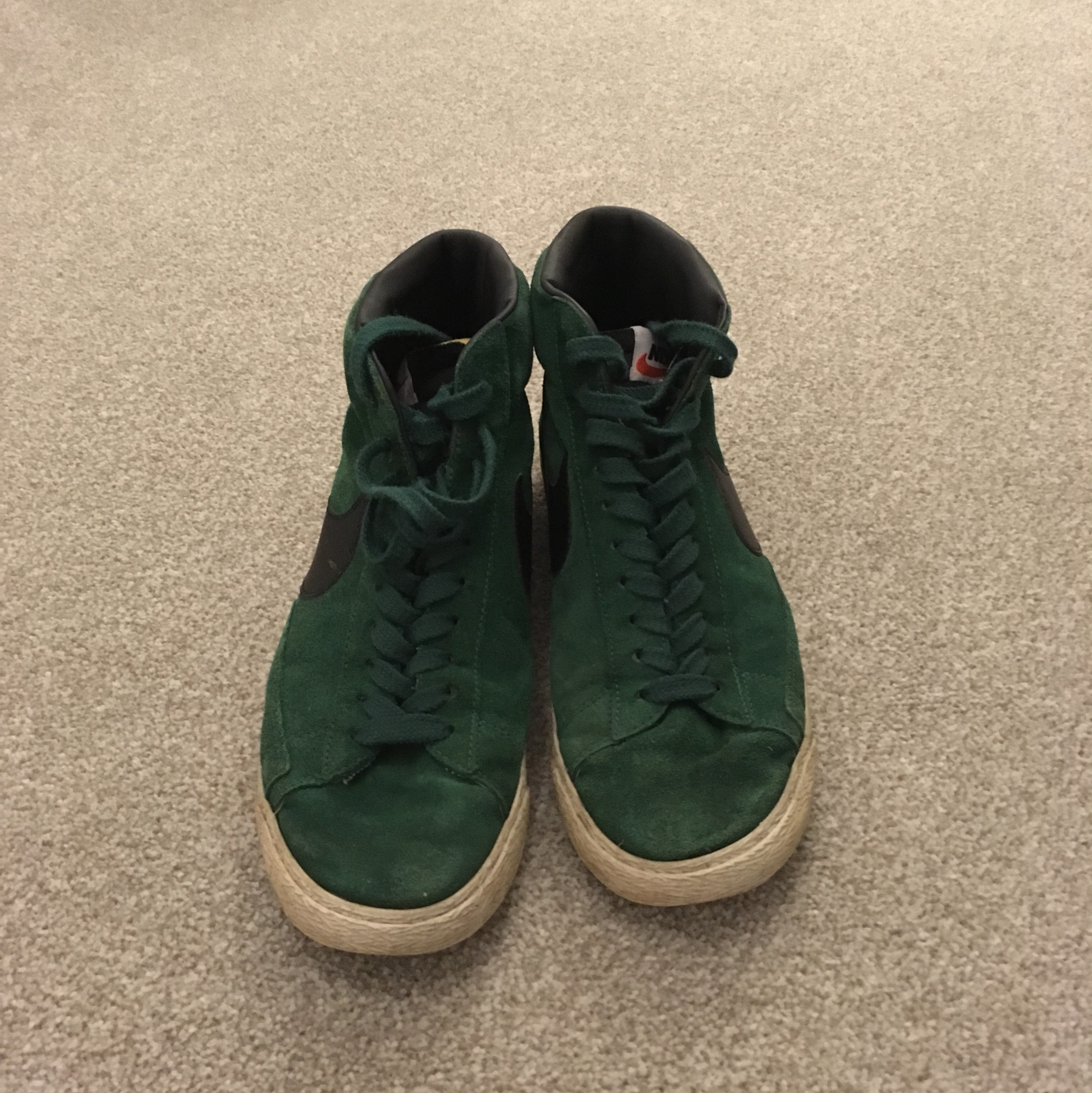 Green suede Nike high tops. Used but