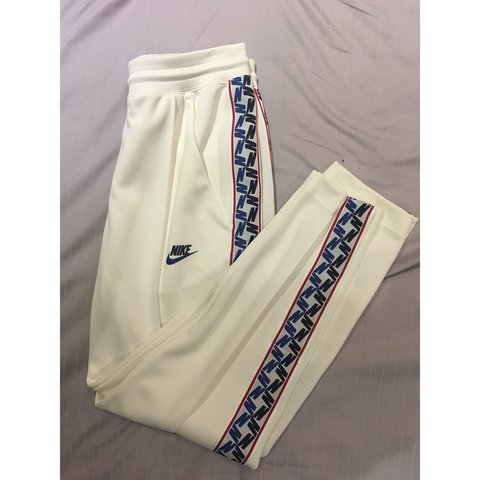 502d9294 @xchrisparkin. 7 months ago. Leeds, United Kingdom. Nike Taped Poly Track  Pants ...