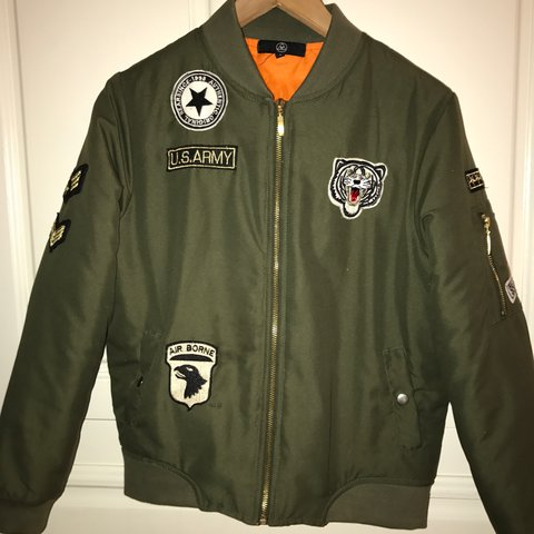 7d23d26ddf Misguided army green bomber jacket with badges and orange - Depop