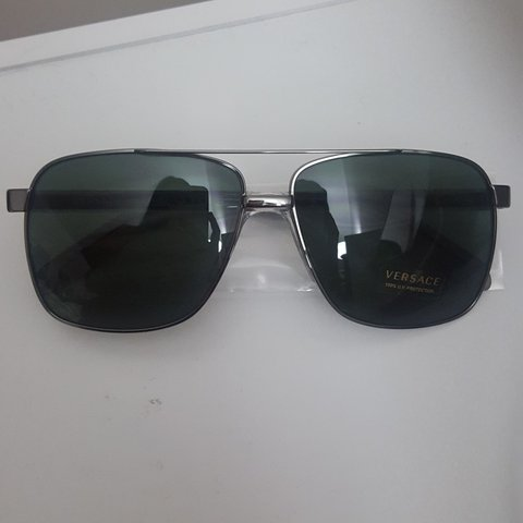 9d0f0215daa9 Versace sunglasses. Lens are green and are not polarized. & - Depop