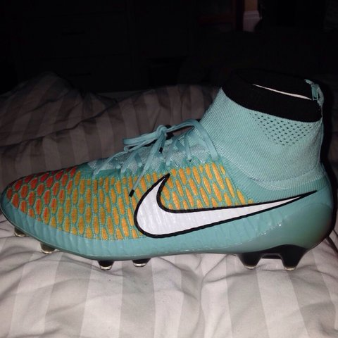 0c47a306849b  meganbibby1. 4 years ago. United Kingdom. Nike Magista Obra FG - Hyper Turq  White Laser Orange ...