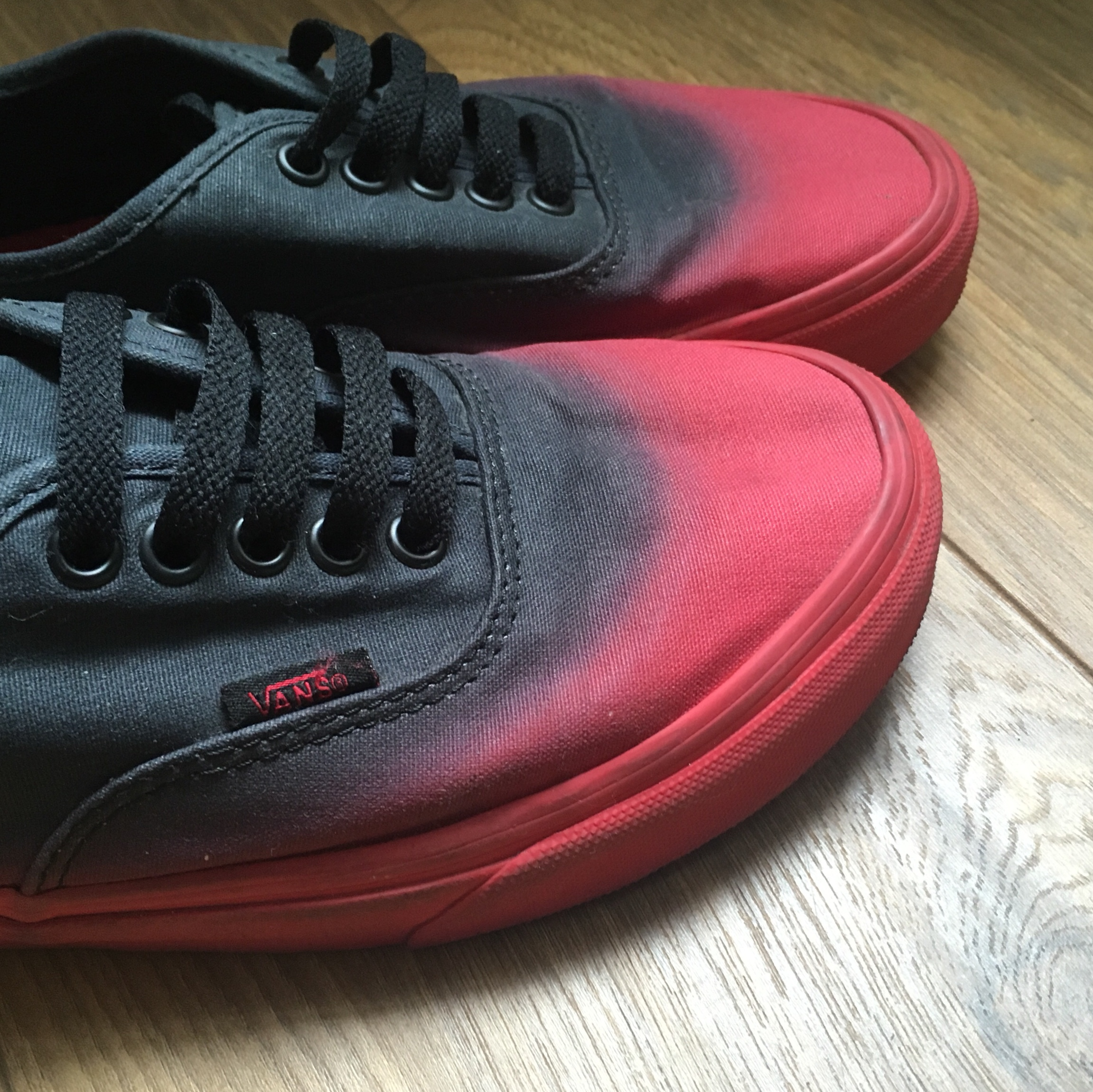 red and black faded vans