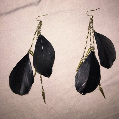 7e651b357 Black feather and gold arrow dangle earrings Never been in - Depop