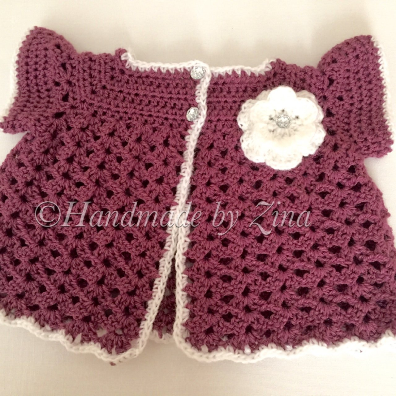 b0aa18213516 handmade  crochet  baby cardigan with white flower and Size - Depop