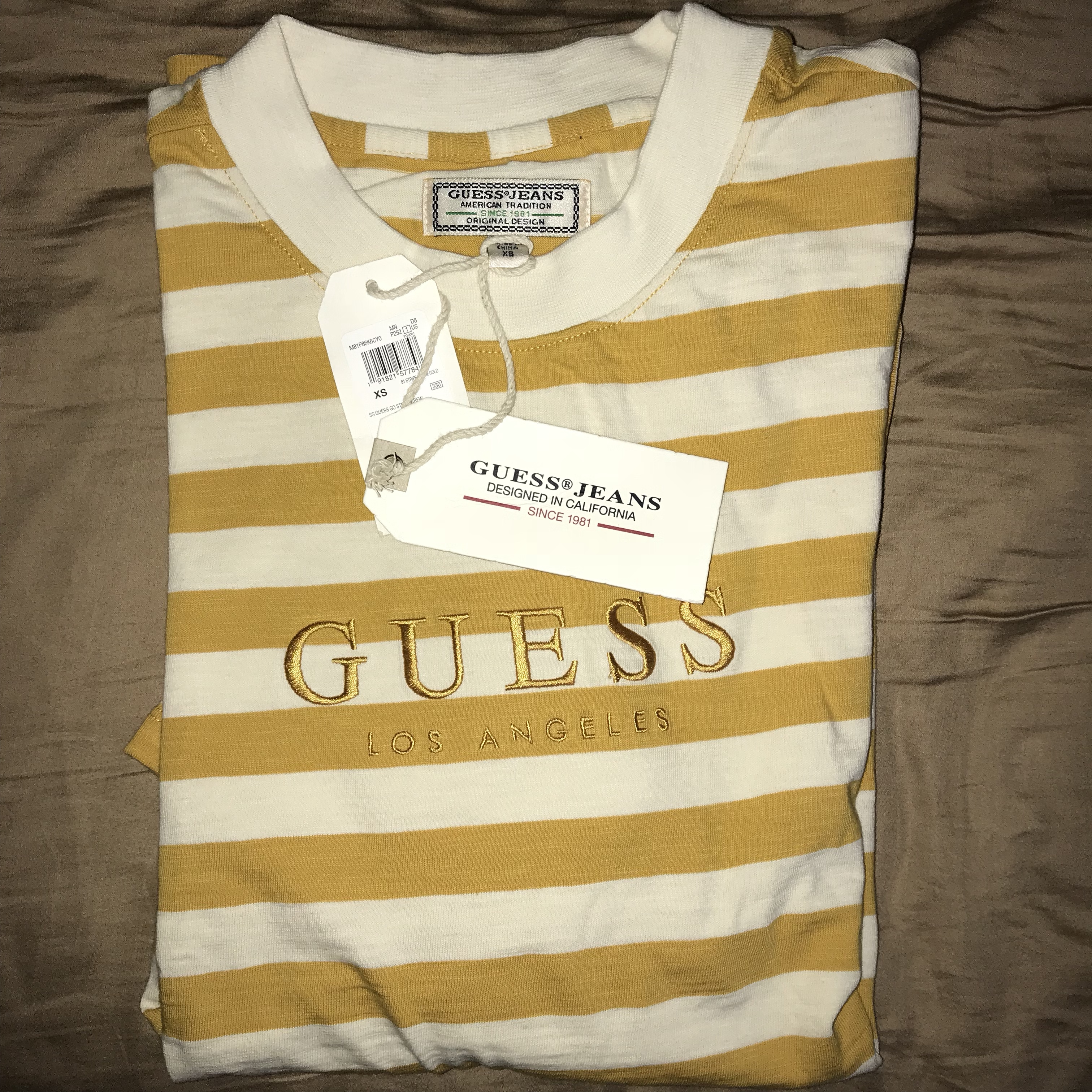 fc0794382f4f Guess Originals yellow striped T-shirt Sold Out in... - Depop
