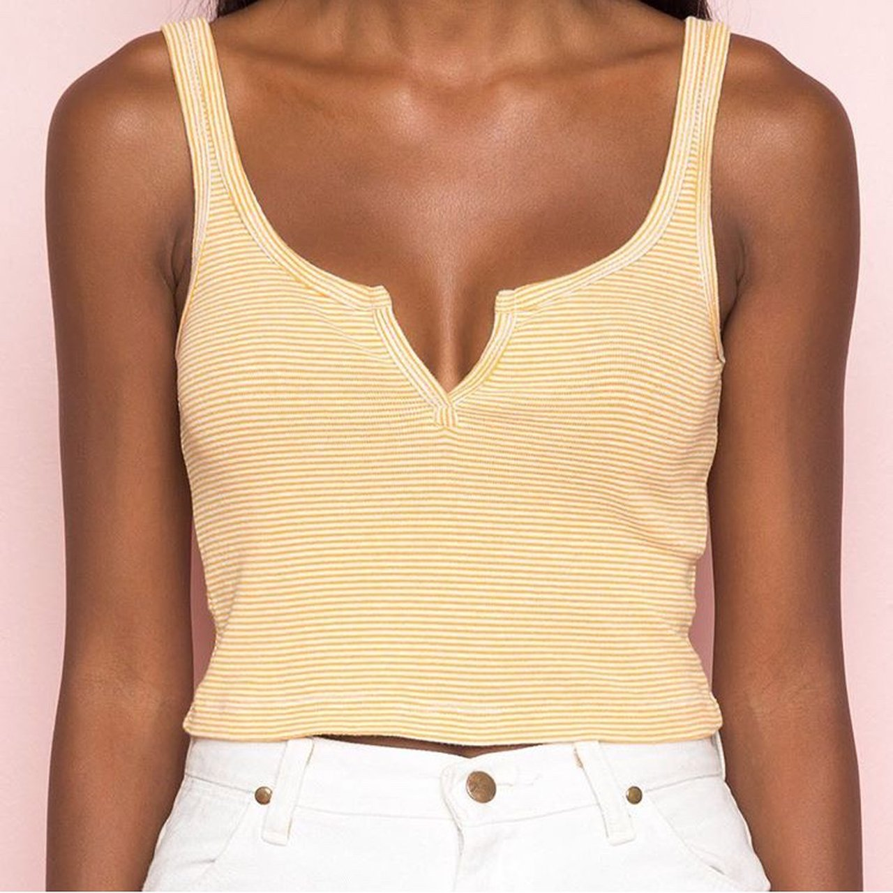985503672dffea  dtaa. last year. United States. Brandy Melville yellow striped trisha tank