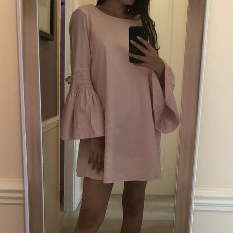 59f1e36b Baby pink playsuit/dress with flared sleeves; says XS but a - Depop