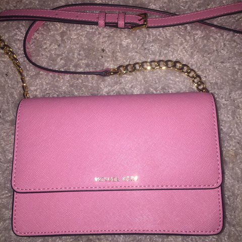 7243420520c7 @dbirkin. last year. Worksop, United Kingdom. Michael Kors baby pink clutch