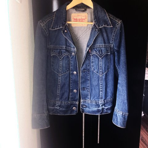 f592358f0f0 @crownss. 2 years ago. United Kingdom. Vintage 90's Levi's oversized denim  jacket with red tab logo at pocket .