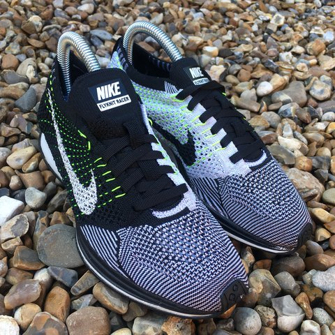 d24d2f4f22bd Nike Flyknit Racer Black   White Size 6. Trainers are in a a - Depop