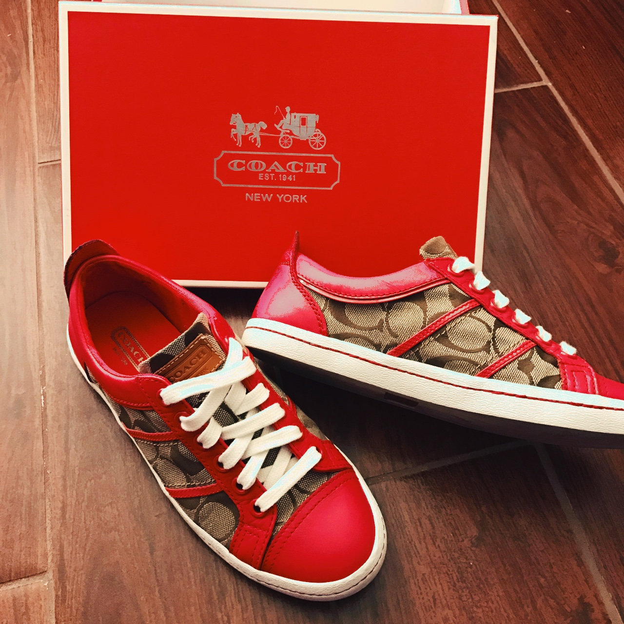 Coach tennis shoes. Red, white, and