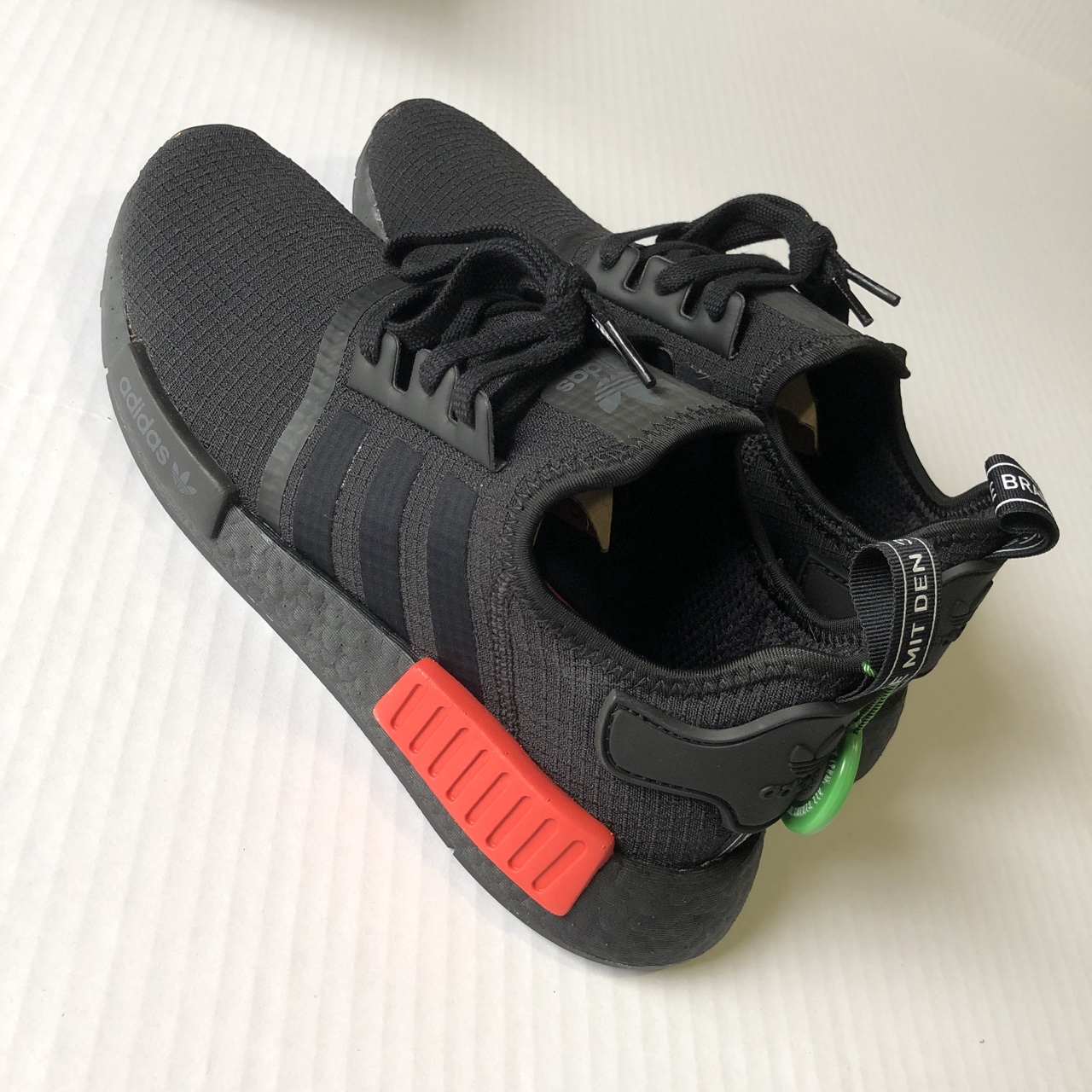 competitive price 75871 76a6a Adidas nmd r1 Core Black/black/lush red StockX... - Depop
