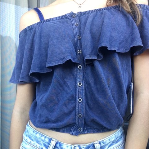 489fb3310bbeb0 @zanesmith. 10 months ago. Los Angeles, United States. Navy blue Free  People button up ruffle shirt.