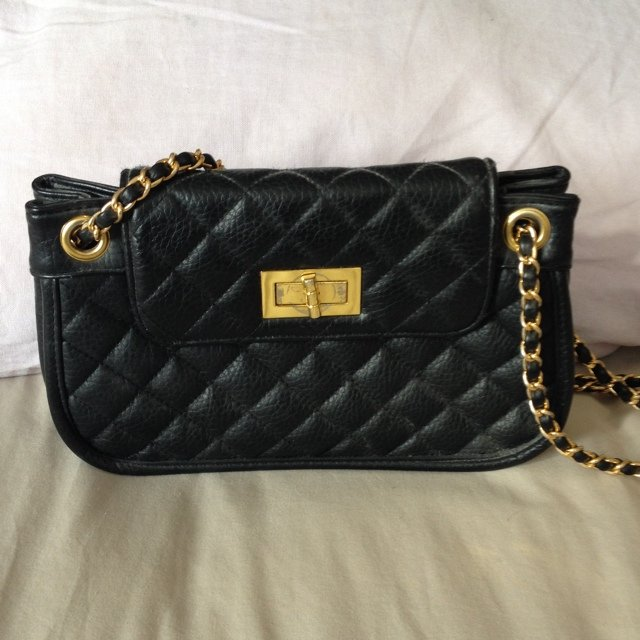 972dba85902  becca1927. 5 years ago. Topshop faux leather quilted handbag in Chanel bag  style. Chain handle with gold ...