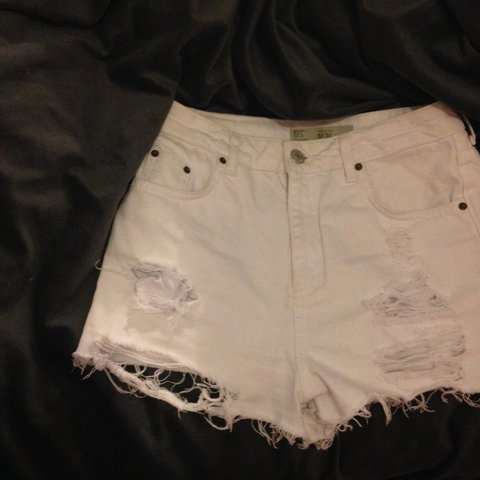 50e56ccbac9 White ripped  mom shorts from  topshop