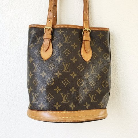 1056c438f @honeydipvintage. last year. Los Angeles, CA, USA. ✨Authentic Louis Vuitton  Petit Bucket Bag✨ Vintage ...