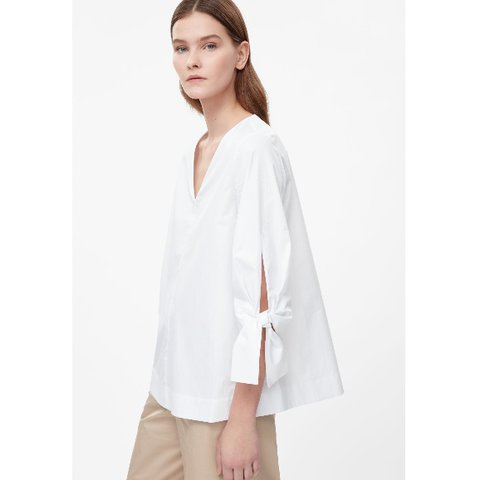 38396069030f6b @rianne0. 11 months ago. London, United Kingdom. COS white tied sleeves  blouse ...
