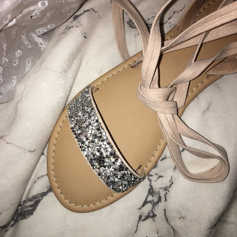 826ca1e68011 Brand new never been worn embellished tie up sandals. Flat - Depop