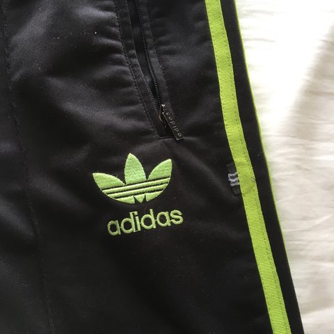 dd19a619777f Vintage black Adidas tracksuit bottoms with lime green and 8 - Depop