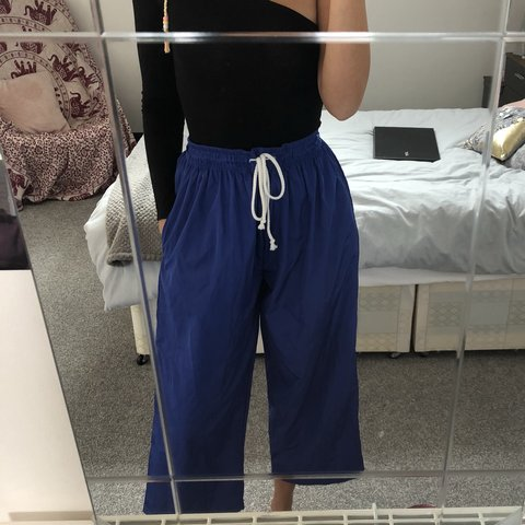ed409de7a8e4 Blue shell suit jogger style, cropped trouser, size 8 but a - Depop