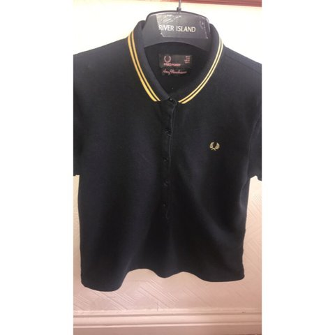ca5456bf47f0 @jennpallagi. 2 years ago. Stockport, United Kingdom. Real Amy Winehouse  Fred Perry black and yellow polo ...