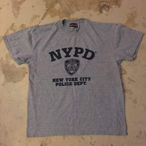 30556de72 @jcallyron. last year. Miami, United States. NYPD New York City Police  Department officially licensed grey T