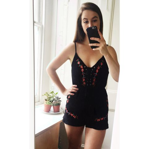 cac78090e7 Black lace up playsuit with red floral embroidery detail