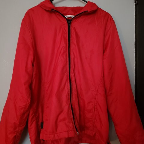 a8cb6859 @balleberry. 9 months ago. New York, US. Bright red Tommy Hilfiger zip up  windbreaker with hood.