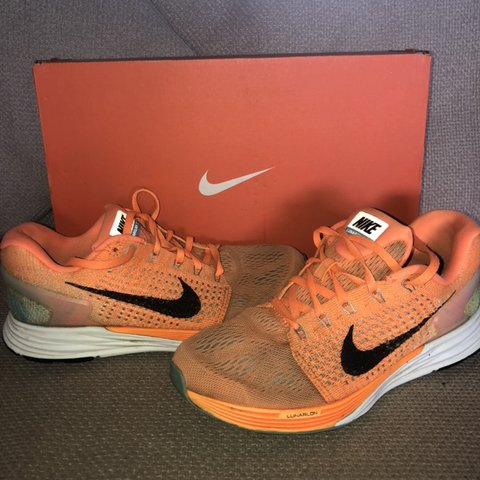 detailed look 018f5 674a5  spro04. last month. United Kingdom. Nike Lunarglide 7 running gym  trainers. Orange and green flyknit