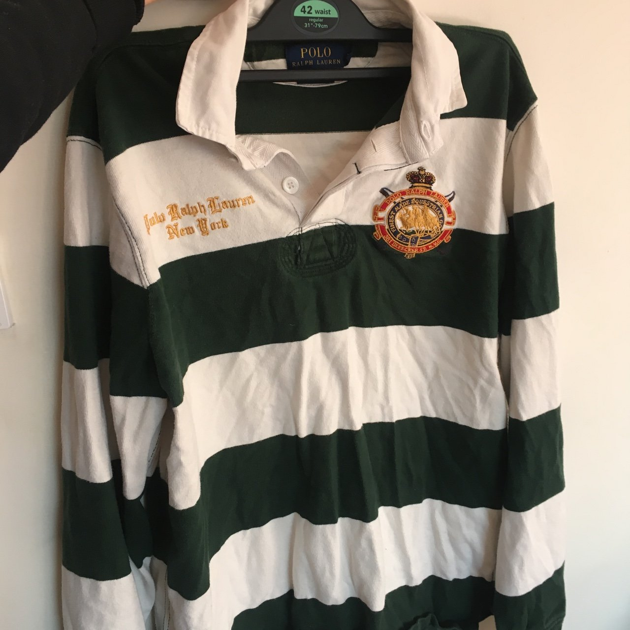 35c3d504 @amberdc. 8 months ago. Great Yarmouth, United Kingdom. Ralph Lauren green  and white striped 'rugby top' styled shirt. Size medium.