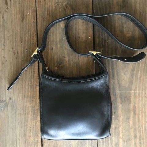 9cbf07f046a @madamemacgee. last year. Peachtree City, United States. Vintage black Coach  bag with adjustable strap! So cute!!