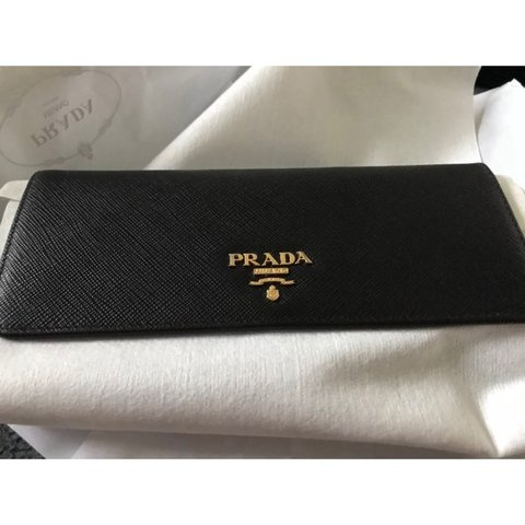 efba77ad003da8 @iak94. 2 years ago. Burton upon Trent, United Kingdom. PRADA SAFFIANO  LEATHER FLAP WALLET ...