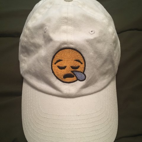 white hat with emoji in front never warn just a stain on depop