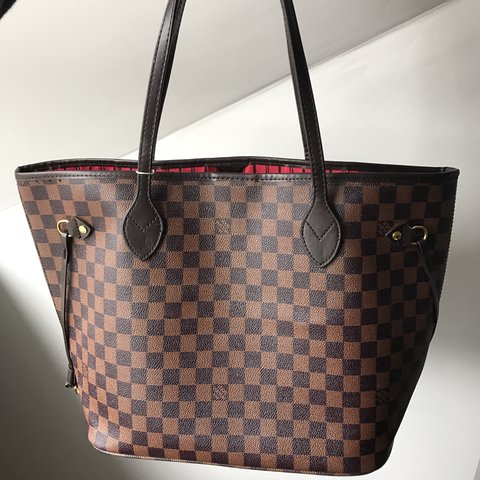 8a2224035c4  sarahhmangan. 5 months ago. Cork, Ireland. Louis Vuitton Neverfull dark  brown with red interior brand new never used!