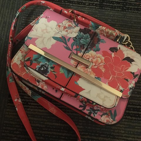 1e6631977 @charldawsonn. 2 years ago. Leeds, UK. Small river island bag. Cute pink/red  and green floral print.