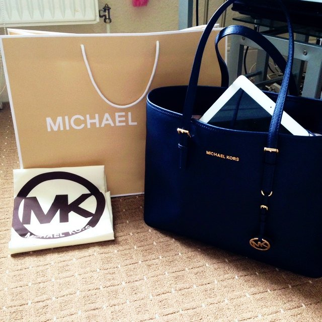 4f7dde01cc6e Michael Kors Jet Set Travel Navy Blue saffiano leather- gold - Depop