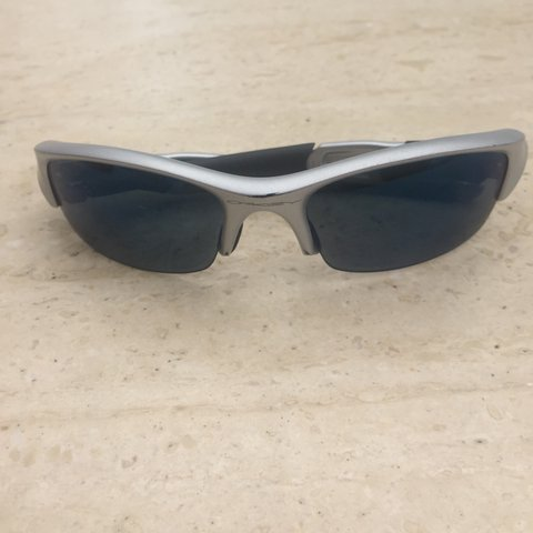 229648e15f Silver Oakley sunglasses with blue lenses - a couple of for - Depop